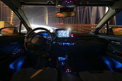 Concept of the cockpit of an autonomous car driving at night ill. Uminated by a tunnel stock photos