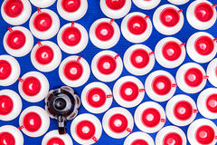 Concept of coffee on demand. Overhead background pattern of multiple bright colorful cups and saucers in patriot American red, white and blue with a full coffee Stock Images