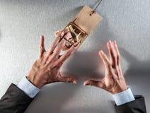 Concept collectieve hebzucht met verraste zakenman die contant geld vangen stock fotografie