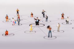 The concept of a collective solution to any problem. Miniature toy workers. Close-up view Royalty Free Stock Photos