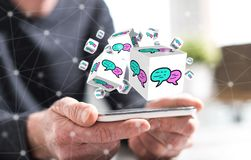 Concept of communication. Hands of man holding a smartphone with communication concept stock images