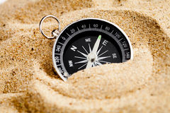 Concept compass in sand searching meaning of life Royalty Free Stock Photography