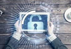 Concept of computer access with media lock icon on tablet screen Stock Image
