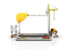 Concept of computer design. Laptop with white blank screen near tower crane and construction tools on a white background stock illustration