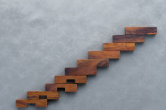 Concept or conceptual brown wood or wooden stair or steps  on fl Royalty Free Stock Images