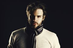 Concept of confidence. Man with beard and attentive look wears scarf with stripes. Concept of confidence. Man with beard and attentive look wears scarf with royalty free stock photos