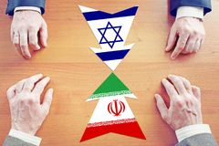 Concept of confrontation between Iran and Israel. Diplomacy and hard talks Stock Photos