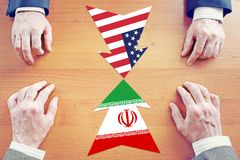 Concept of confrontation between Iran and United States. Diplomacy and hard talks royalty free stock images