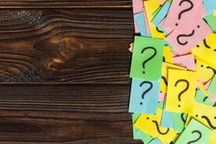 Concept for confusion, question or solution. question mark on wooden background.  Royalty Free Stock Photos