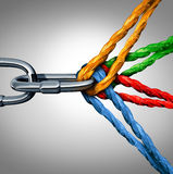 Concept Of Connection. As a connected group symbol with different ropes tied and linked together pulling on a metal chain as an unbreakable link as a community Royalty Free Stock Photo