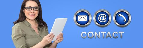 Concept of contact. Woman using digital tablet with contact concept on background royalty free stock photos