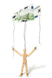 Concept of controlled marionette. Concept, a puppet controlled by money, giving it freedom Stock Image