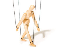 Concept of controlled marionette. Wooden puppet isolated on white Stock Photography