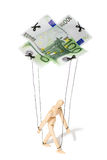 Concept of controlled marionette. Concept, a puppet controlled by money Royalty Free Stock Image