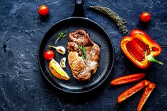 Concept cooked steak on dark background top view.  stock photos