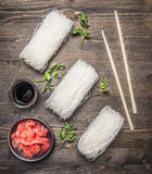 Concept cooking Korean food, glass noodles with herbs wooden rustic background top view Stock Images