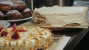 The concept of cooking. Professional pastry chef makes a delicious cake, closeup. The concept of cooking. A professional pastry chef prepares a delicious cake stock footage