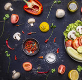 Concept cooking vegetarian food on pan mushroom parsley tomato salt hot red pepper and lemon Stock Image