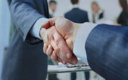 Concept of cooperation.businessman handshake invites to cooperat Royalty Free Stock Image