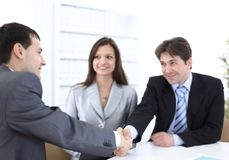 Handshake business partners in the workplace Royalty Free Stock Images