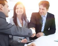 Handshake business partners in the workplace Royalty Free Stock Photo
