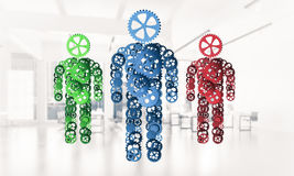 Concept of cooperation or partnership with three figures present Stock Image