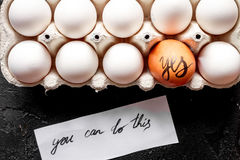 Concept of correct choice eggs on dark background top view Royalty Free Stock Image
