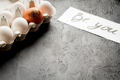 Concept of correct choice eggs on dark background top view Stock Photography