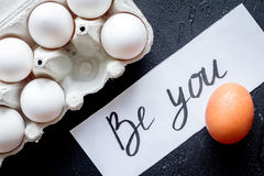 Concept of correct choice eggs on dark background top view Stock Photos