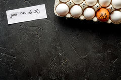 Concept of correct choice eggs on dark background top view Stock Photo