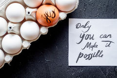 Concept of correct choice eggs on dark background top view Royalty Free Stock Images