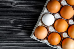 Concept of correct choice eggs on wooden background top view Stock Image