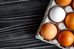 Concept of correct choice eggs on wooden background top view Royalty Free Stock Photo