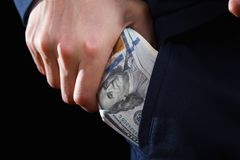 Concept for corruption, bankruptcy, bail, crime, bribing, fraud. Bundle of dollar cash in hand. Concept for corruption, bankruptcy, bail, crime, bribing, fraud Royalty Free Stock Photos