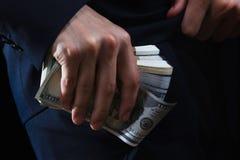 Concept for corruption, bankruptcy, bail, crime, bribing, fraud. Bundle of dollar cash in hand. Concept for corruption, bankruptcy, bail, crime, bribing, fraud stock images