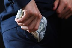Concept for corruption, bankruptcy, bail, crime, bribing, fraud. Bundle of dollar cash in hand. Concept for corruption, bankruptcy, bail, crime, bribing, fraud Royalty Free Stock Image
