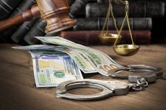 Concept For Corruption, Bankruptcy Court, Bail, Crime, Bribing,. Fraud, Judges Gavel, Soundboard And Bundle Of Dollar Cash On The Rough Wooden Textured Table stock photo