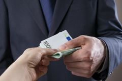 Concept - corruption. Giving a bribe. Money in hand Royalty Free Stock Images