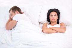 Concept for couple after a quarrel in bed Royalty Free Stock Images