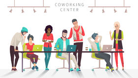 Concept of the coworking center. Business meeting. Multicultural team. Shared working environment. People talking and working  at the computers in the open Royalty Free Stock Images