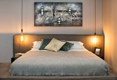 Concept of cozy bedroom with warm lamps stock images