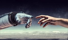 Concept of creation. Mixed media. Astronauts hands in touch as symbol for creation. Mixed media Royalty Free Stock Image