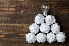 Concept creative idea. concept of creative idea. Bulbs of crumpled paper and light bulb. metaphor, inspiration stock image