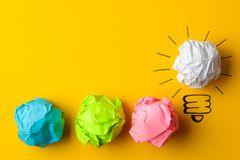 Concept creative idea. concept of creative idea. Crumpled paper balls and painted light bulb on bright background. metaphor, inspi. Ration royalty free stock photography