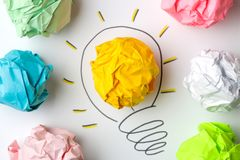Concept creative idea. concept of creative idea. Crumpled paper balls and painted light bulb on bright background. metaphor, inspi. Ration royalty free stock photo