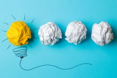 Concept creative idea. concept of creative idea. Crumpled paper balls and painted light bulb on bright background. metaphor, inspi. Ration royalty free stock photos