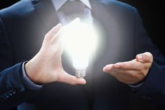 Concept of creative and inspiration idea. Hands of businessman holding illuminated light bulb. Concept of creative and inspiration idea. Hands of businessman Royalty Free Stock Photos
