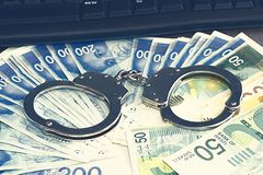 Concept criminal hacker in handcuffs. Close-up view stock image