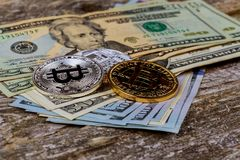 The concept of crypto currency Bitcoin and dollar. Bitcoin and dollar The concept of crypto currency. dollars bills coin bitcoin royalty free stock images