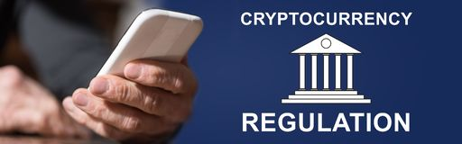 Concept of cryptocurrency regulation. Hand holding mobil phone with cryptocurrency regulation concept on background royalty free stock photo